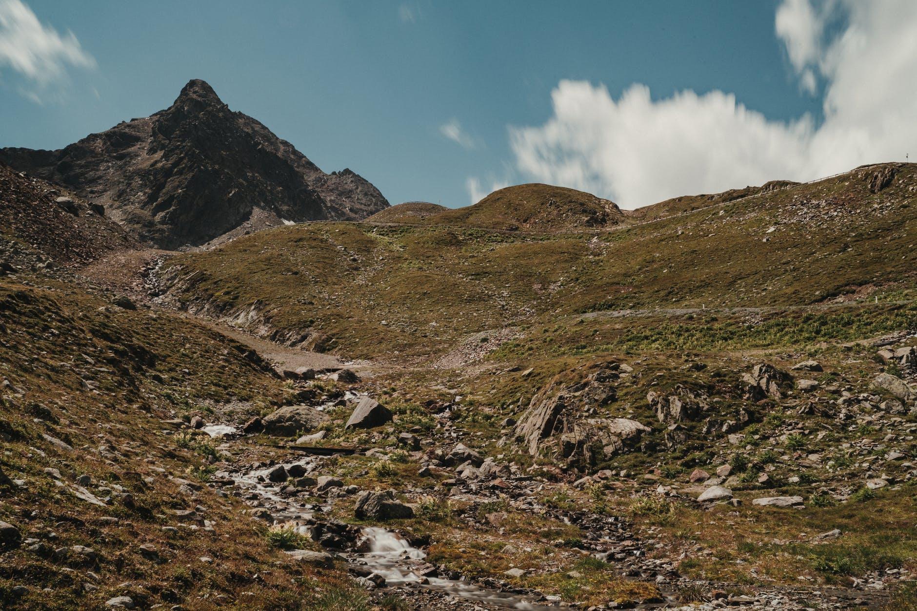 rocky terrain with high mountain